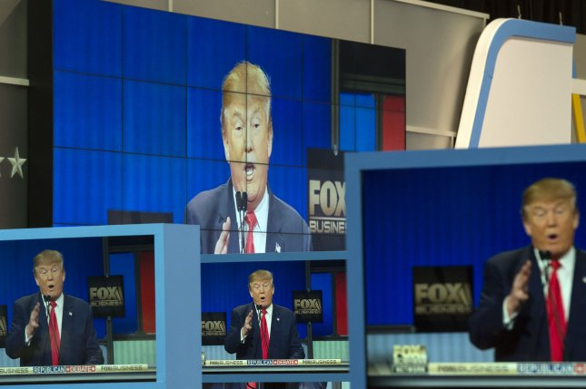 Republican presidential candidates Donald Trump is seen on television screens in the media room at the Republican presidential debate in North Charleston, South Carolina on January 14, 2016. Photo by Kevin Dietsch/UPI