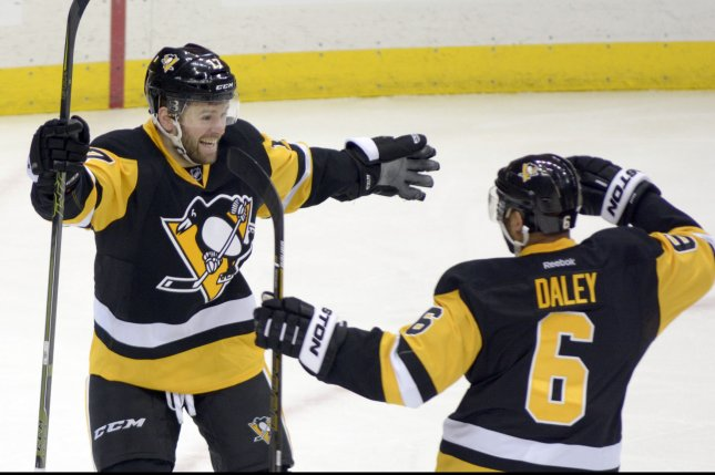 Pittsburgh Penguins right wing Bryan Rust (17) celebrates his goal with Penguins defenseman Trevor Daley (6) during the second period against the New York Rangers in game five of the first round of the Stanley Cup playoffs at the Consol Energy Center in Pittsburgh on April 23, 2016. Photo by Archie Carpenter/UPI