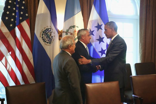 Former Guatemalan President Otto Perez Molina shakes hands with President Barack Obama during a meeting at the White House in 2014. Molina and his vice president, Roxana Baldetti, were forced to resign last year amid a corruption scandal. On Thursday, they were also charged with misappropriating millions in government funds. File Photo by Alex Wong/Pool/UPI