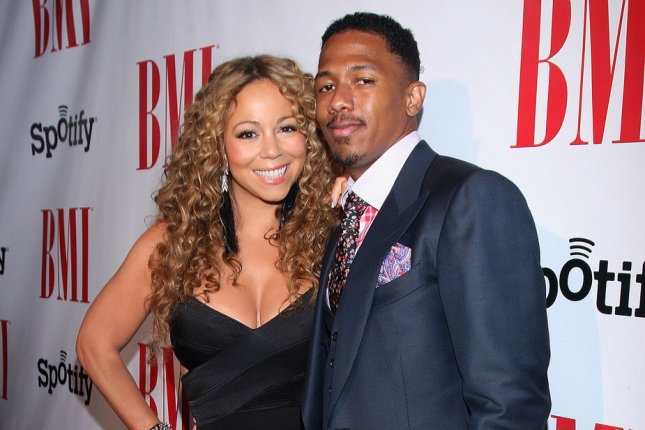 Nick Cannon (R) and Mariah Carey at the BMI Urban Music Awards on September 7, 2012. File Photo by Arnold Turner/UPI