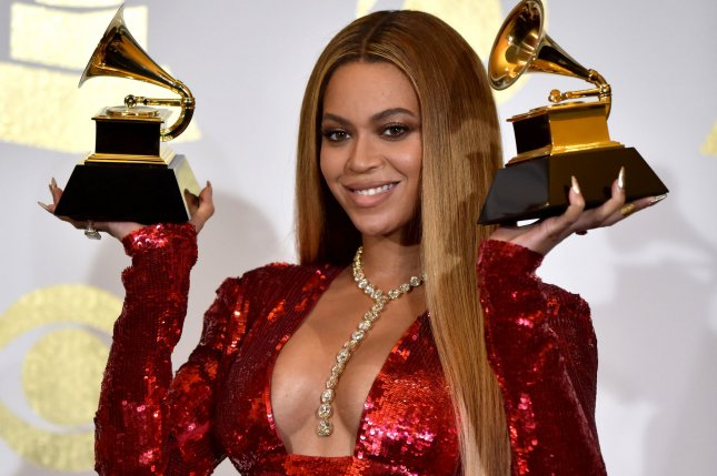 Beyonce appears backstage during the 59th annual Grammy Awards on February 12. Beyonce has released a remix to Mi Gente to help with hurricane and earthquake relief efforts. File Photo by Christine Chew/UPI
