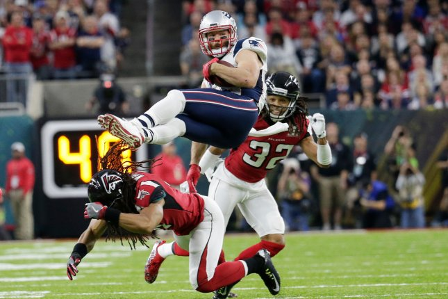 New England Patriots receiver Julian Edelman is flipped in the air by Atlanta Falcons linebacker Philip Wheeler during Super Bowl LI in February 2017. Photo by John Angelillo/UPI