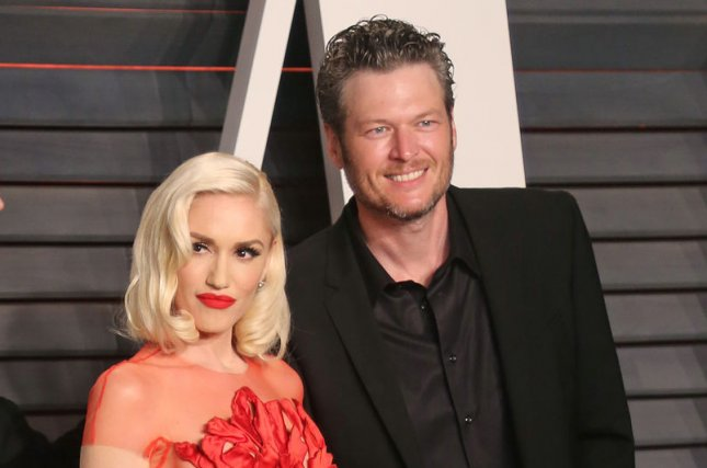 Gwen Stefani (L), pictured with Blake Shelton, spent Saturday at Lake Texoma with the country star and her sons. File Photo by David Silpa/UPI