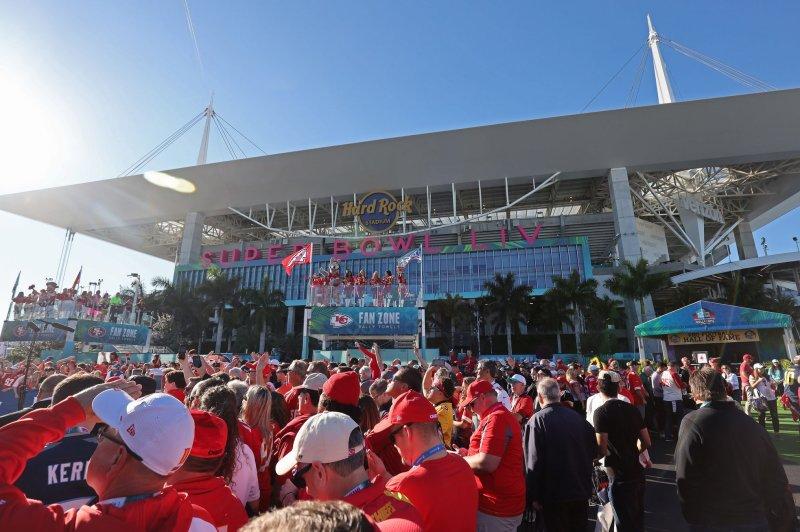 Fans crowd the Fan Zone for Super Bowl LIV on Sunday at Hard Rock Stadium in Miami Gardens, Fla. Photo by Tasos Katopodis/UPI
