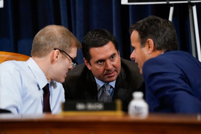 Intelligence Committee ranking member Devin Nunes (C), R-Calif., and Rep. Jim Jordan (L), R-Ohio, are to receive the Presidential Medal of Freedom in coming days. File Photo by Kevin Dietsch/UPI