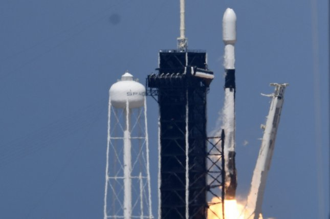 A SpaceX Falcon 9 rocket launches a 26th set of Starlink satellites at 3:01 p.m. Tuesday from Complex 39A at Kennedy Space Center in Florida. Photo by Joe Marino/UPI
