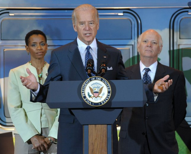 Vice President Joe Biden announces $300 million in funding from the American Recovery and Reinvestment Act for state and local governments, and transit authorities to expand the nationÕs fleet of clean, sustainable vehicles and the fueling infrastructure necessary to support them on Earth Day at the New Carrollton WMATA (Washington Metropolitan Area Transit Authority) Station in Landover, Maryland, on April 22, 2009. With Biden from left are Rep. Donna Edwards, D-MD, and Sen. Ben Cardin, D-MD. (UPI Photo/Roger L. Wollenberg)