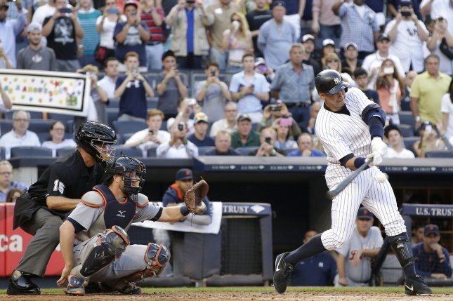 Detroit Tigers Bryan Holaday is in position behind the plate when New York Yankees Alex Rodriguez hits career MLB hit number 3000 with a solo home run off of Detroit Tigers starting pitcher Justin Verlander in the first inning at Yankee Stadium in New York City on June 19, 2015. Photo by John Angelillo/UPI