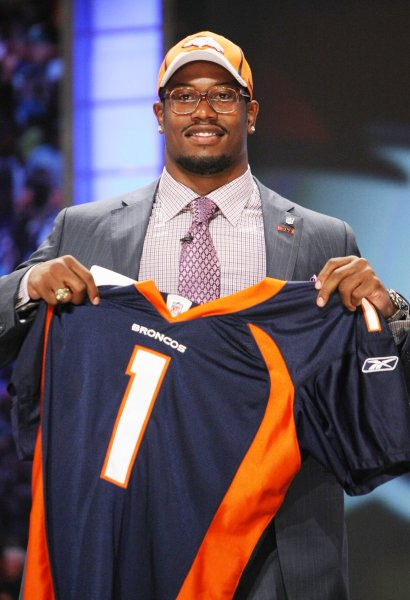 Von Miller, the number two overall pick of the 2011 NFL Draft holds up his new jersey after being selected by the Denver Broncos. Cam Newton was selected first overall by the Carolina Panthers. UPI/Monika Graff