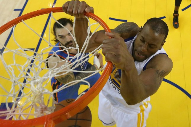 Golden State Warriors' Andre Iguodala dunks on Oklahoma City Thunder's Steven Adams in the first half of game 7 of the NBA basketball Western Conference finals in Oakland, California on May 30, 2016. Pool photo by Ezra Shaw/UPI