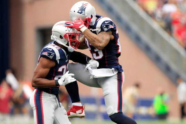 New England Patriots CB Logan Ryan (L) celebrates after a fumble recovery  against the Miami Dolphins at on September 18 1c3f37811