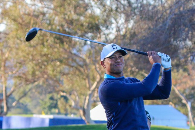 Tiger Woods tees off on the 6th hole during the Pro-Am round of the Farmers Insurance Open Wednesday at Torrey Pines in La Jolla, Calif. Photo by Howard Shen/UPI