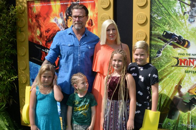 Tori Spelling, pictured with Dean McDermott and their kids, prepared a special meal with her family Tuesday. File Photo by Jim Ruymen/UPI