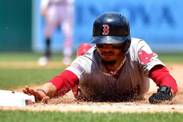 14f1c3e3d Boston Red Sox right fielder Mookie Betts (50) slides back into first in  the sixth inning against the Washington Nationals on July 4 at Nationals  Park in ...