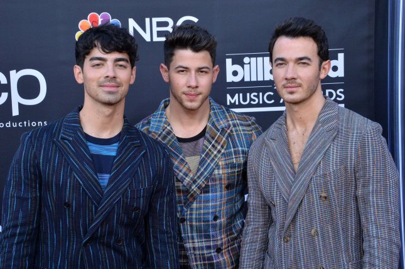 Joe Jonas, Nick Jonas and Kevin Jonas (left to right) said Chasing Happiness will debut June 4 on Amazon Prime. File Photo by Jim Ruymen/UPI