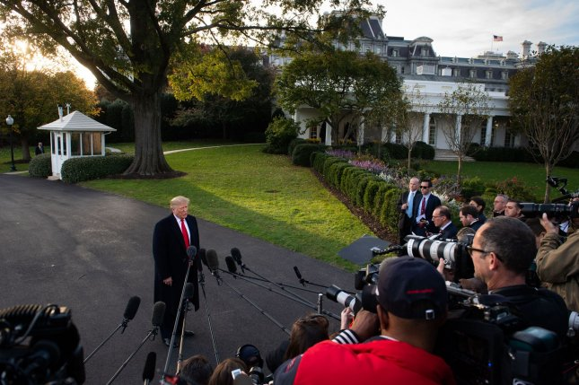 President Donald Trump speaks to reporters Monday before he departs the White House for a trip to Lexington, Ky. Photo by Kevin Dietsch/UPI