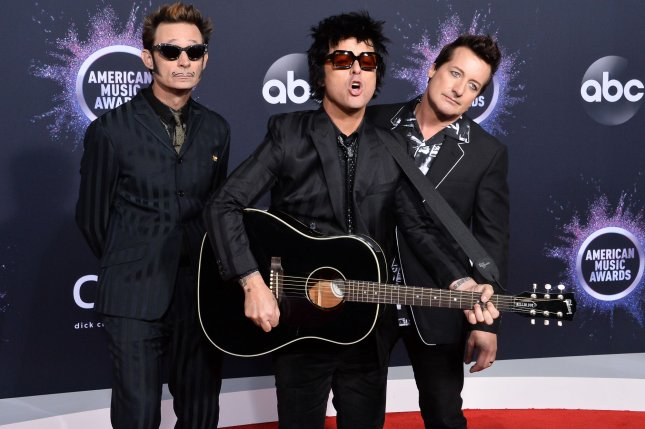 Left to right, Mike Dirnt, Billie Joe Armstrong and Tré Cool of Green Day. The band has postponed a number of concerts in Asia due to the coronavirus. File Photo by Jim Ruymen/UPI
