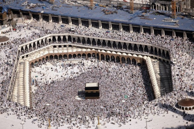 Hundreds of thousands of Muslim pilgrims circle the Ka'baa, which they believe was built by the Prophet Abraham and his son Ismael, at the Grand Mosque in Mecca, Saudi Arabia. File Photo by Mohammad Kheirkhah/UPI