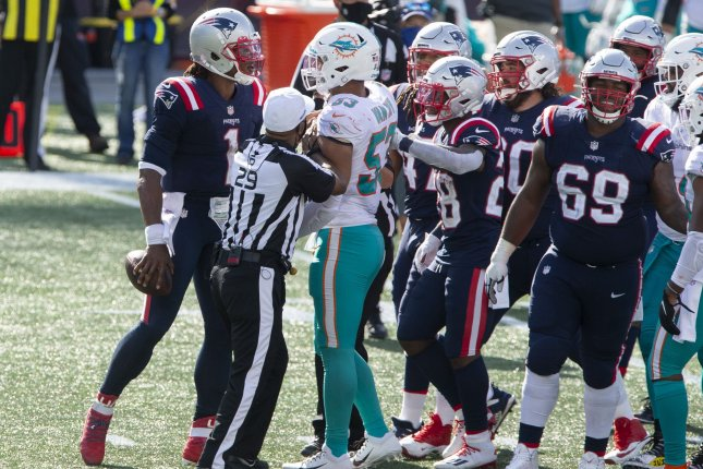 The Miami Dolphins likely will lean on linebackers Andrew Van Ginkel and Kamu Grugier-Hill if Kyle Van Noy (53) is out for Sunday's matchup against the Los Angeles Chargers. File Photo by Matthew Healey/UPI