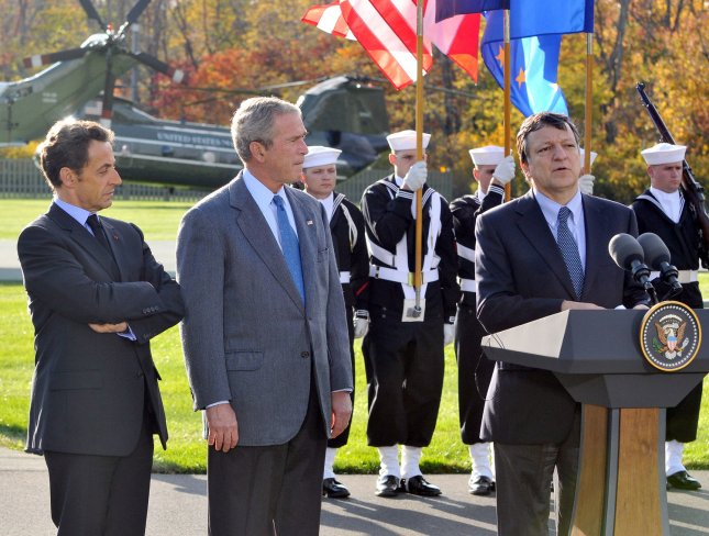 President José Manuel Barroso of the European Commission (EC), left, makes remarks as he and President Nicolas Sarkozy of France, who also serves as this year's rotating President of the European Union (EU), left, are welcomed to the Presidential Retreat by United States President George W. Bush, center, on Saturday, October 18, 2008. The two European leaders stopped at Camp David to meet with President Bush to discuss the economy on their way home from a summit in Canada to try to convince Bush to support a summit by year's end to try to reform the world financial system. (UPI Photo/Ron Sachs/Pool)