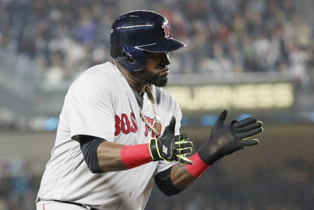 Boston Red Sox David Ortiz reacts on third base after Mookie Betts drives in 2 runs with a double in the 8th inning against the New York Yankees at Yankee Stadium in New York City on September 28, 2016. With a win the Red Sox will clinch the American League East Division. Photo by John Angelillo/UPI