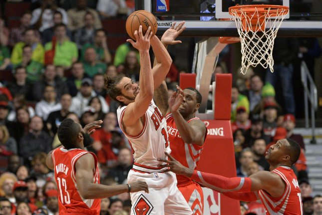 Former Chicago Bulls center Joakim Noah (C) grabs a rebound from Houston Rockets' James Harden (L-R), Terrence Jones and Dwight Howard during the second quarter at the United Center in Chicago on March 13, 2014. File photo by Brian Kersey/UPI