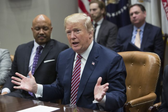 President Donald Trump meets with state and local officials on school safety in the Roosevelt Room at the White House in Washington, D.C., on Thursday. Trump suggested arming teachers would help with school safety. Photo by Chris Kleponis/UPI