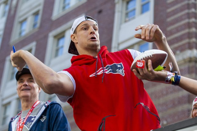 New England Patriots tight end Rob Gronkowski left a baseball-sized dent in the Patriots' sixth Lombardi Trophy after using it as a bat. File Photo by Matthew Healey/UPI