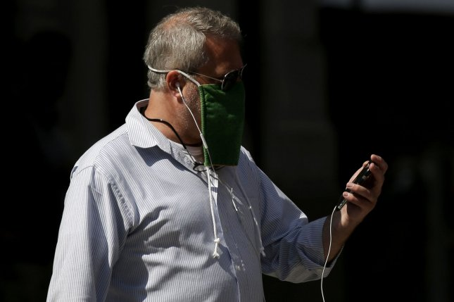 Researchers say some older men have had more severe COVID-19 because of differences in their immune systems. Pictured, a man wears a face mask to prevent spread of the coronavirus as he walks in New York City in August. Photo by John Angelillo/UPI