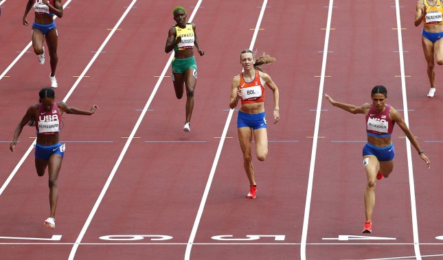 Dalilah Muhammad of the USA, Jamaica's Janieve Russell, Femke Bol of the Netherlands and Sydney McLaughlin of the USA (L to R) cross the finish line in the women's 400-meter hurdles finals during the Tokyo Summer Olympics in Tokyo, Japan, on Wednesday. Photo by Bob Strong/UPI