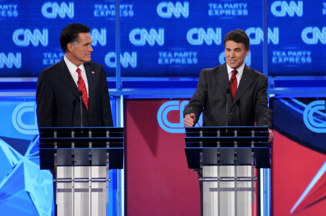 Republican candidates for president Mitt Romney (L) and Gov. Rick Perry participate in a debate in Tampa, Fla., Sept. 12, 2011. UPI/Christina Mendenhall.