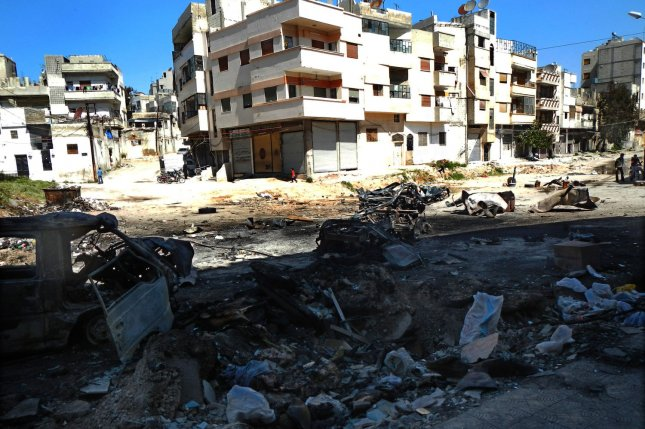 Debris litters the streets of downtown Homs, Syria, on March 21, 2012. On Nov. 1, 2015, Islamic State forces captured the town of Maheen, in Homs province, killing at least 50 government troops in a battle kicked off by two suicide car bombs. The militants also launched an attack on the adjacent town of Sadad, which has a majority Assyrian Christian population. UPI
