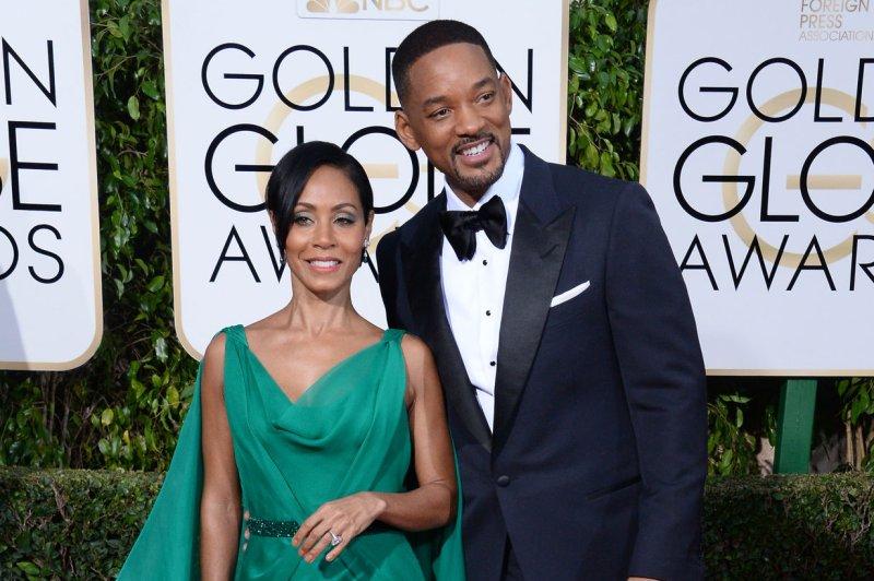 Will Smith (R) and wife Jada Pinkett Smith at the Golden Globe Awards on January 10. The actor will support Jada Pinkett Smith's Oscar boycott. File Photo by Jim Ruymen/UPI