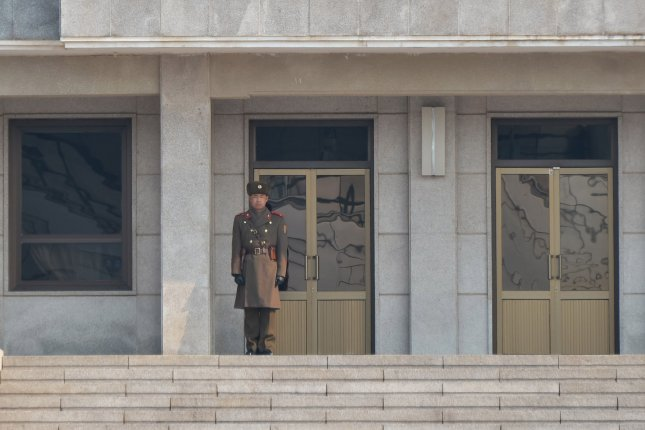 A North Korean border guard stands at the joint security area (JSA) of Panmunjom in the demilitarized zone (DMZ) on the border near Paju, South Korea, on Feb. 18, 2016. Photo by Keizo Mori/UPI