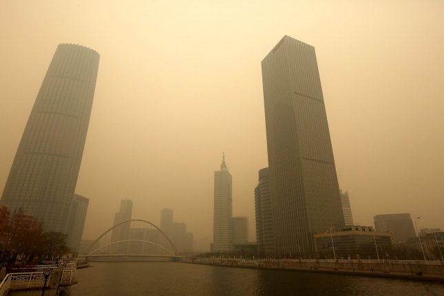 There's evidence to show that breathing dirty air can harm your heart. But a small study suggests that daily vitamin B supplements might counteract that effect. Pictured, the heavy, hazardous smog in downtown Tianjin, a port city east of Beijing, China, hangs over the city on February 20, 2017. Photo by Stephen Shaver/UPI