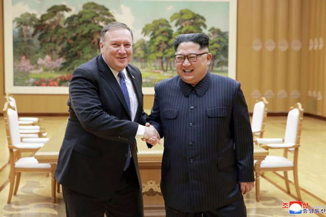 North Korean leader Kim Jong Un meets with U.S. Secretary of State Mike Pompeo to finalize plans for a historic summit between President Donald Trump and Kim, and the return of three Americans who had been detained in North Korea for more than a year. Photo by KCNA/UPI