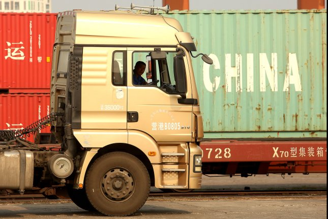 Chinese truck drivers transport cargo containers to a port in Yingkou, China, a major port city in Liaoning Province, on July 18. Photo by Stephen Shaver/UPI