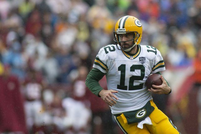 Green Bay Packers quarterback Aaron Rodgers (12) scrambles with the football against the Washington Redskins on September 23, 2018 at FedEx Field in Landover, Maryland. Photo by Alex Edelman/UPI