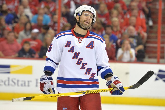 Former New York Rangers forward Martin St. Louis (26) will join the Columbus Blue Jackets as a special teams consultant, the team announced Monday. File photo by Kevin Dietsch/UPI