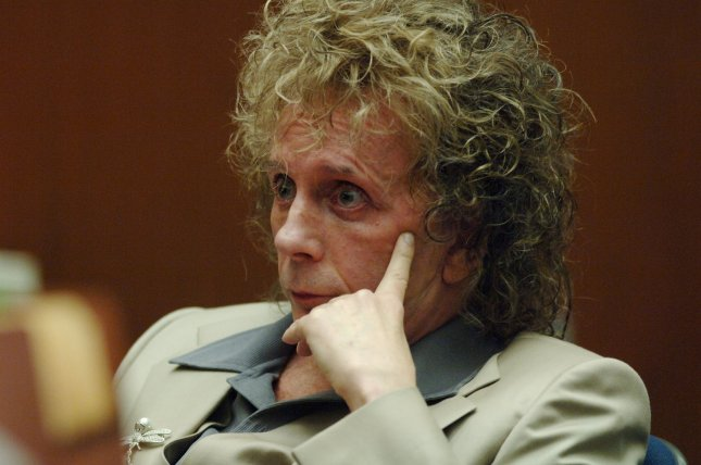 Phil Spector listens to comments by the prosecutor as he appears for a pretrial hearing at the Los Angeles Superior Court in downtown Los Angeles October 27, 2005. On April 13, 2009, the music producer was found guilty of second-degree murder by a Los Angeles jury in his second trial for the 2003 slaying of Lana Clarkson, an actress and club hostess. He was sentenced to 19 years-to-life in prison. File Photo by Jim Ruymen/UPI
