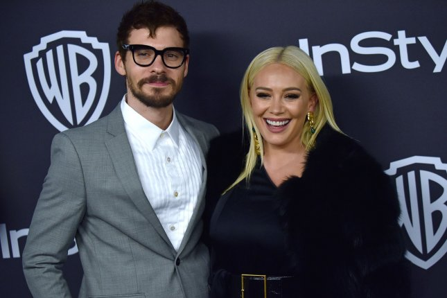 Hilary Duff (R), pictured with Matthew Koma, took to Instagram after saying yes to the DJ and singer. File Photo by Christine Chew/UPI