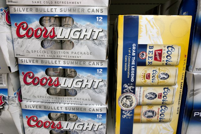 Molson Coors announced Wednesday that it will lay off about 500 workers and legally change its name to Molson Coors Beverage Company after reporting third-quarter losses. File Photo by Gary C. Caskey/UPI