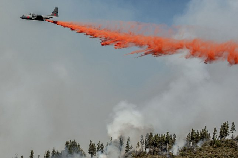 A National Guard C-130 tanker drops retardant to slow down active fire on Crocker Ridge below Pilot Peak near Yosemite National Park, California on August 28, 2013. UPI/Al Golub