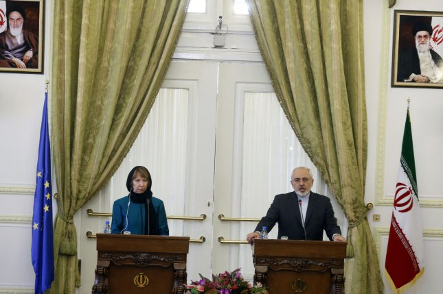Iranian Foreign Minister Mohammad Javad Zarif (R) and European Uunion foreign policy chief Catherine Ashton, who coordinates nuclear talks between Iran and world powers, participate in a joint press conference at the Iranian Foreign Ministry in Tehran, Iran on March 9, 2014. UPI/Maryam Rahmanian