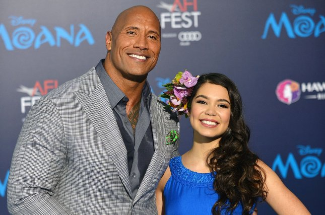 Dwayne Johnson and Auli'i Cravalho arrive at the world premiere of Walt Disney Animation Studios' 'Moana' at Hollywood's El Capitan Theatre in Los Angeles, California on November 14, 2016. Photo by Christine Chew/UPI