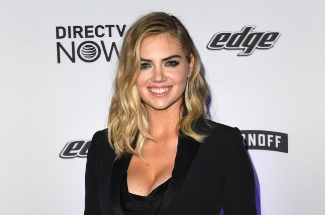 Model Kate Upton poses with copies of the 2017 Sports Illustrated Swimsuit issue at the launch event on February 16 in New York City. Upton will be seen on Thursday's edition of Lip Sync Battle. File Photo by Andrea Hanks/UPI