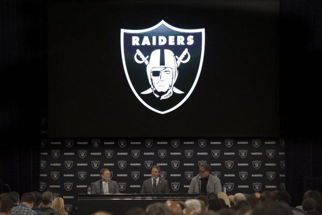 Oakland Raiders new head coach John Gruden (C) answers questions with owner Mark Davis (L) and Reggie McKenzie at the Raiders Headquarters on January 9 in Alameda, Calif. Photo by Terry Schmitt/UPI