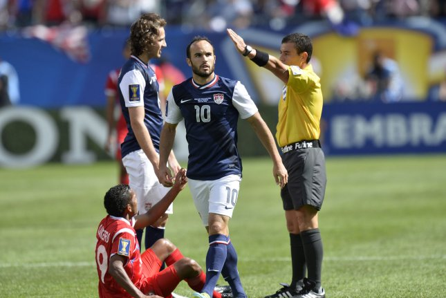 United States forward Landon Donovan walks away after being called for a foul on Panama midfielder Alberto Quintero during the first half of the 2013 CONCACAF Gold Cup Final at Soldier Field in Chicago. File photo by Brian Kersey/UPI