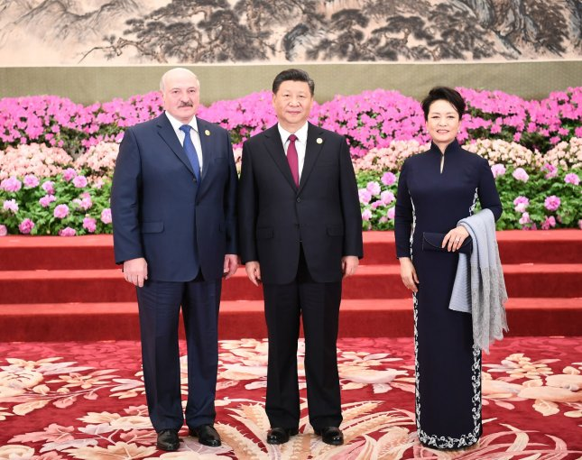 Chinese President Xi Jinping (C) and his wife Peng Liyuan pose for a photo with Belarusian President Alexander Lukashenko before a banquet Saturday as part of the Second Belt and Road Forum for International Cooperation in Beijing. Photo by Xie Huanchi/UPI/pool