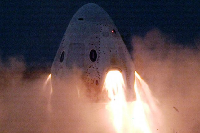 SpaceX's Crew Dragon spacecraft is shown in a test firing in November. Photo courtesy of SpaceX
